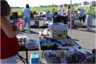 table full of baked goods at the garage sale